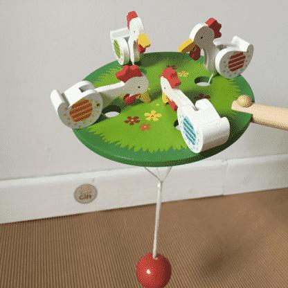 Poules qui picorent - jouet traditionel
