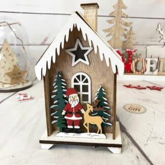 Décoration de noël - Père noël dans sa petite maison en bois lumineuse