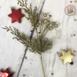 Décoration de Noël - Branche recouverte de paillettes dorées