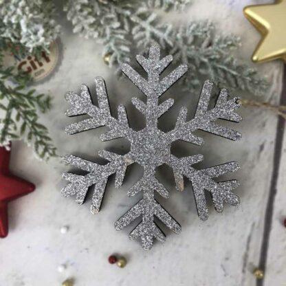 Décoration de noël à suspendre - Flocon de neige en bois pailleté argenté