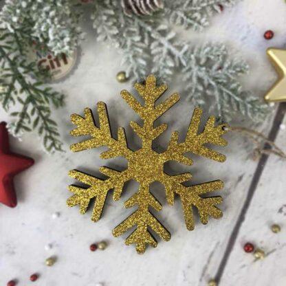 Décoration de noël à suspendre - Flocon de neige en bois pailleté doré