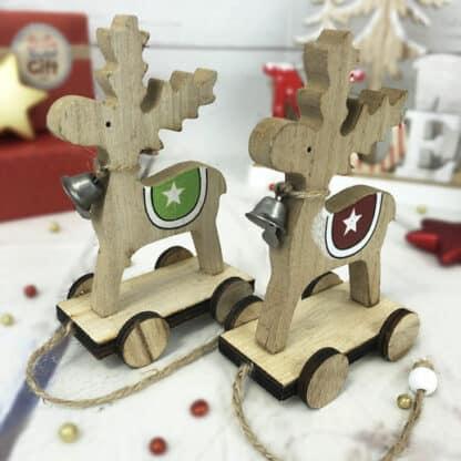 Lot de 2 rennes en bois sur roulette