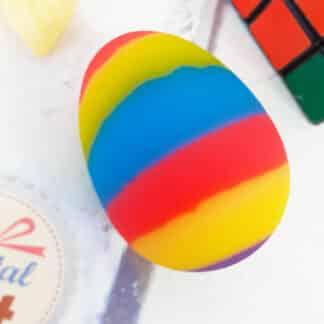 Balle rebondissante - Œuf rayé multicolore